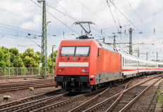 Electric locomotive with passenger train in Cologne. Electric locomotive with passenger train on Cologne station, Germany royalty free stock photos