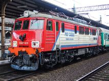 Electric locomotive of PKP Cargo operator on Gdansk Central terminal. Old electric EU07 loco operated by Polish cargo operator on Danzig Central terminal. Engine Royalty Free Stock Images