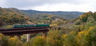 Electric locomotives on the bridge in mountains Royalty Free Stock Image