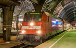 Electric lovomotive with regional express train in Karlsruhe Stock Photo