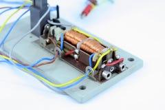 Electric magnet. Small electric magnet. Electric magnet with wires. Small electromagnet Stock Image