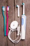 Electric and manual toothbrushes on the wooden background Stock Images
