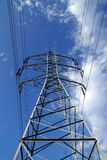 Electric mast pole tower pilot on blue cloud sky Royalty Free Stock Photos