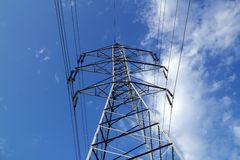 Electric mast pole tower pilot on blue cloud sky Stock Photography