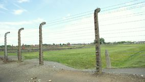 Electric metal gates and barbed wire fences in concentration camp
