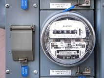 Electric meter. Processed by: Helicon Filter; Electric meter at apartment building Stock Photos