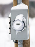Electric meter box. In winter Stock Photos