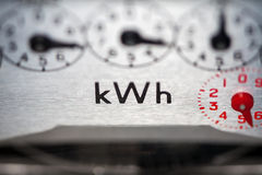 Electric meter close-up. An electric meter showing 4 dials and kWh symbol Royalty Free Stock Image