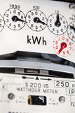 Electric meter close-up. An electric meter showing dials and kWh symbol Royalty Free Stock Photography