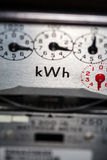 Electric meter close-up. An electric meter showing kWh symbol Stock Photos