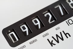 Electric meter dial close-up. Electricity meter dial close-up and showing kilowatt hour stock image