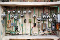 Electric meter messy electrical installation Royalty Free Stock Photography
