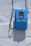Electric meter on wall Stock Photo