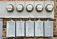 Electric Meters On Side of Old House Converted to Apartments 1 Revised Royalty Free Stock Photo