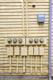 Electric Meters On Side of Old House Royalty Free Stock Photo