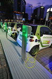 Electric Mini Cars At Charging Station Stock Photos