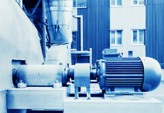 Electric motor in factory. Toned blue tone royalty free stock photos