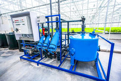 Electric motor water pump at greenhouse. Electric motor water pump for hydroponics plantation system at greenhouse Stock Images