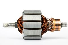 Electric motor on a white background. Electric motor isolated on a white background closeup stock photography