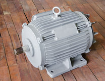 Electric Motor on wooden background.  royalty free stock photography