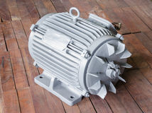 Electric Motor on wooden background Stock Image