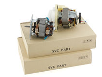 Electric motors and cardboard boxes Royalty Free Stock Photography