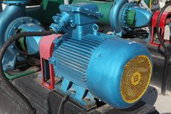 Electric motors driving Stock Images