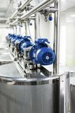 Electric motors on steel tanks for mixing liquids, modern production of alcoholic beverages. Food industry stock photography