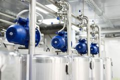 Electric motors on steel tanks for mixing liquids, modern production of alcoholic beverages. Food industry stock image