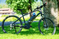 Electric mountain bike on the grass. An electric mountain bike on the grass stock photography