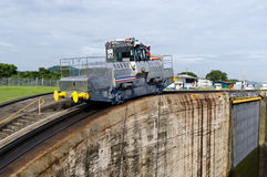 Electric mule guides ships through Panama Canal Stock Photography