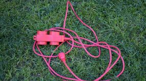 Electric , multiple socket on a green grass. green energy concept,image Stock Photos