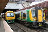 Electric multiple units, Birmingham International. Class 323 and 350 electric multiple units (emu) in London Midland livery stand at platforms in Birmingham Royalty Free Stock Photo