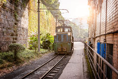 Electric narrow-gauge locomotive with the coal loaded freight train. Stock Photos