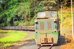 Electric narrow-gauge locomotive. Stock Photo