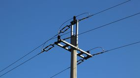 Electric network. Ecology of power. Technical pole. Iron construction on a blue sky. Strategic resources. Tutorial of school. Electric network. Ecology of power Royalty Free Stock Photo