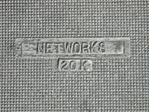 Electric networks as text on vintage manhole Stock Image