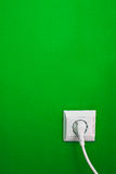 Electric outlet on green wall Stock Photo