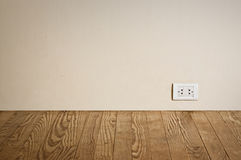 Electric outlet in old wall. Stock Photo