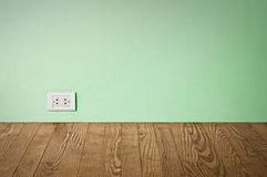 Electric outlet in old wall. Royalty Free Stock Photo