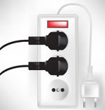 Electric outlet power with two cables. Plugged Stock Photos