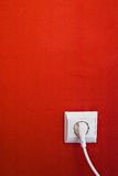 Electric outlet on red wall Royalty Free Stock Image