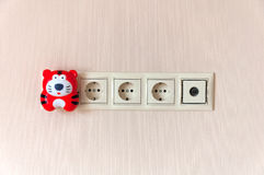 Electric outlet on wall and a night light Royalty Free Stock Photos