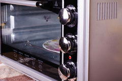 Electric Oven gray-black color. Gray Electric stove in the kitchen Royalty Free Stock Photos