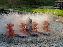 Electric paddle wheel aerator Stock Photography
