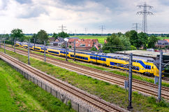 Electric Passenger Train on a Cloudy Spring Day Royalty Free Stock Photo