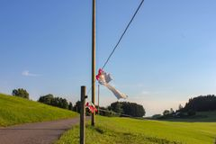 Electric pasture fence. In south germany bavaria allgau summer evening blue sky green grass Stock Photo