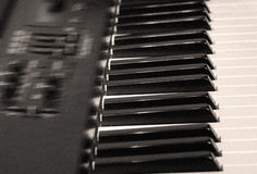 Electric piano. With sepia tint and motion blur Stock Image