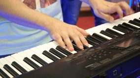 Electric piano, Actor playing on the keyboard synthesizer piano keys. Musician plays a musical instrument on the concert stock video