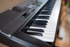 Electric piano in a room stock image